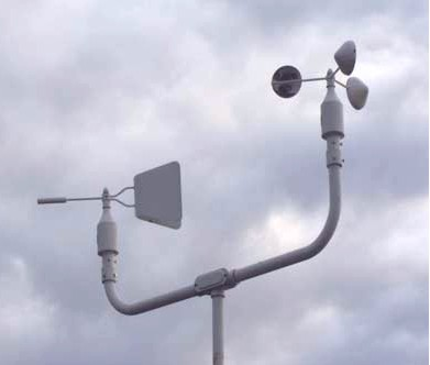 A wind vane and rotating cup anemometer.